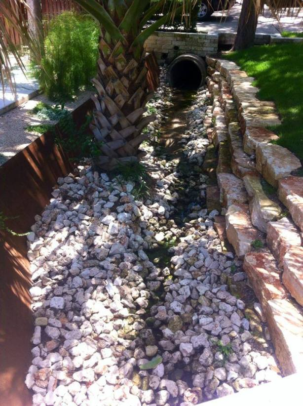 Removing The Rocks From A Residential Drainage Ditch